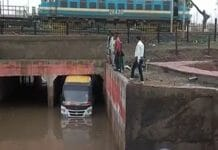 Bus-filled-with-passengers-trapped-under-railway-under-bridge