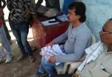 Voter-slip-with-photo-of-BJP-candidate-and-PM-Modi-distributed-to-voters-in-jabalpur
